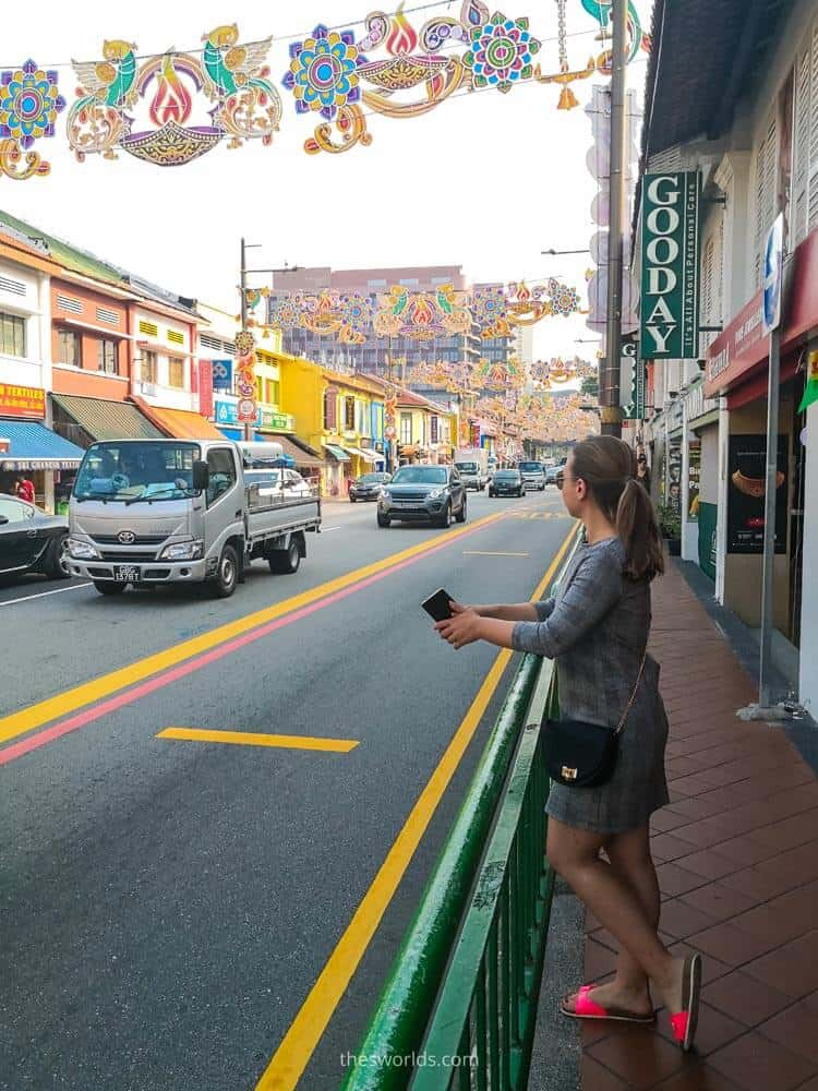 Girl standing next to street in India neighborhood in Singapore