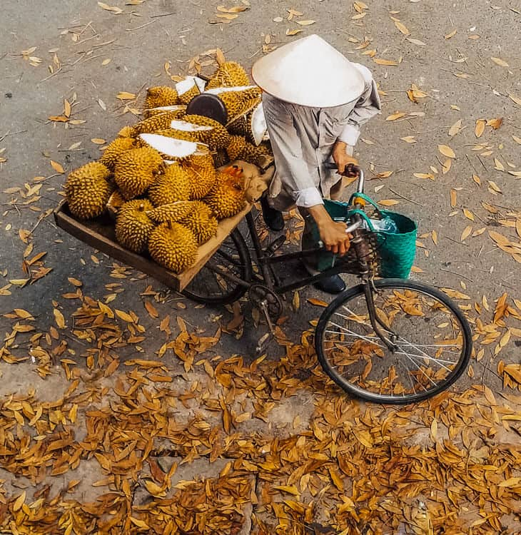 Person with bicycle selling durian in Singapore