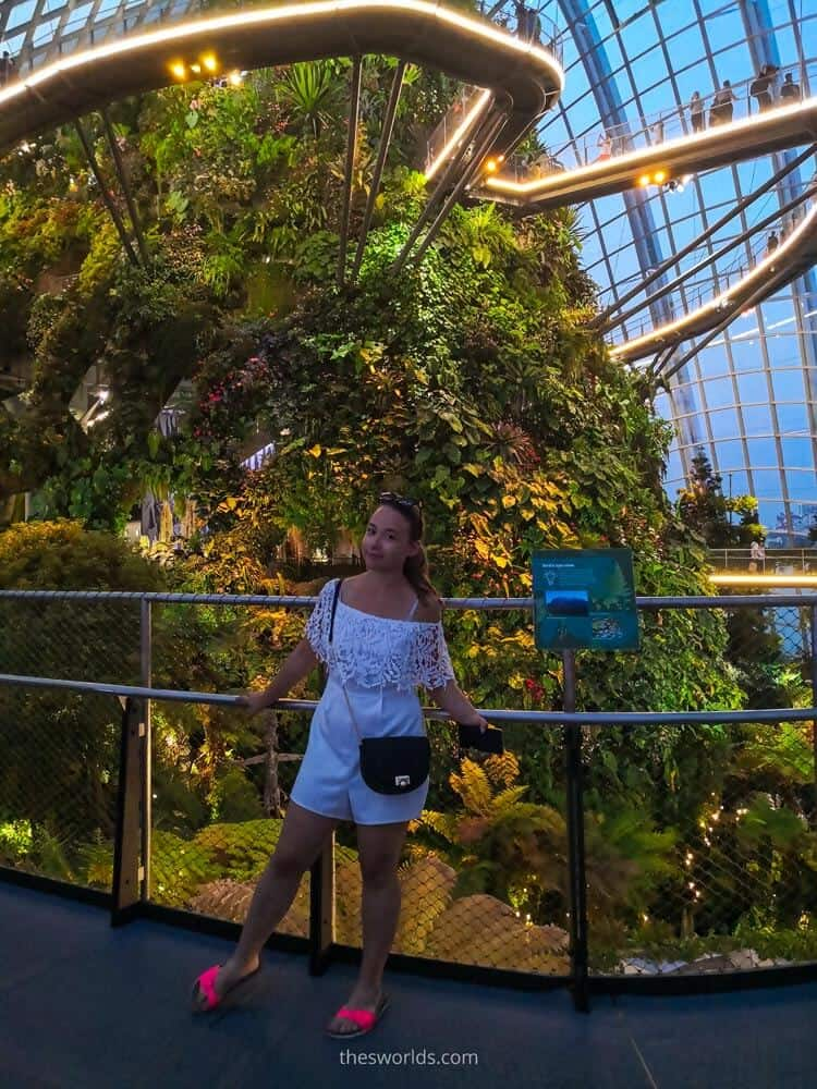 Girl posing at upper deck of cloud forest in Singapore