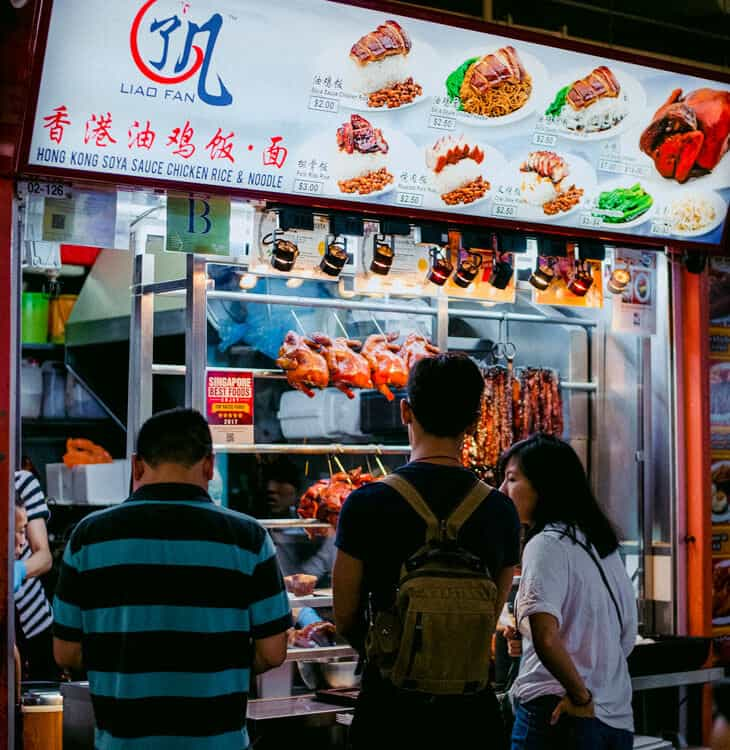 People waiting to be served at fast food stand in Singapore