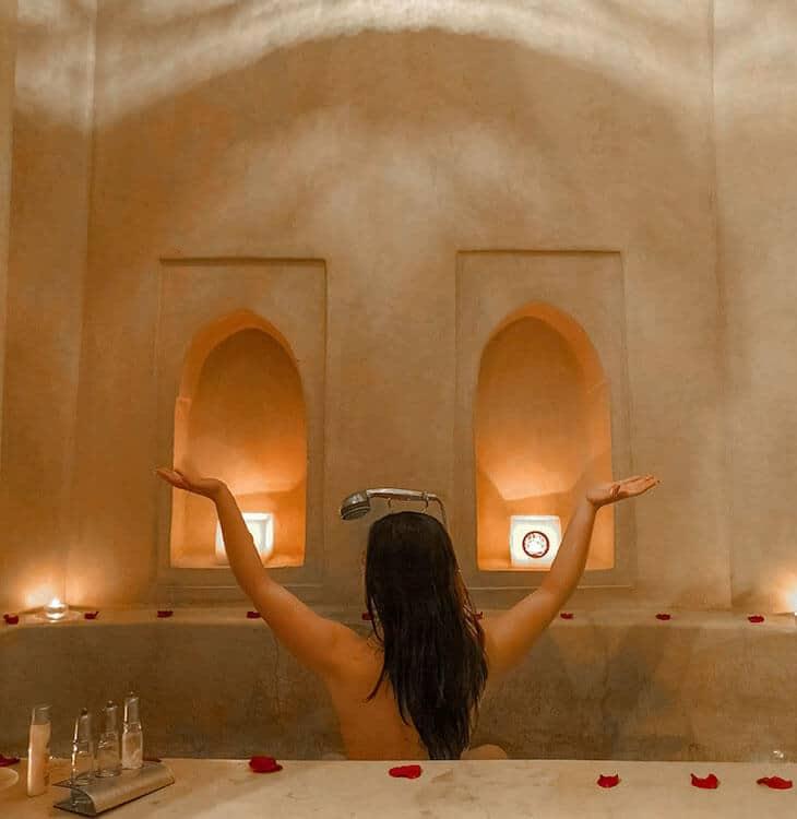 Girl posing in bathtub in Marrakech