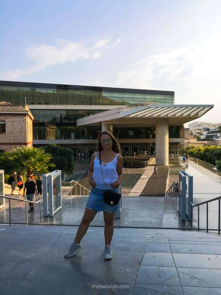 Girl standing in front of entrance to acropolis museum in Athens