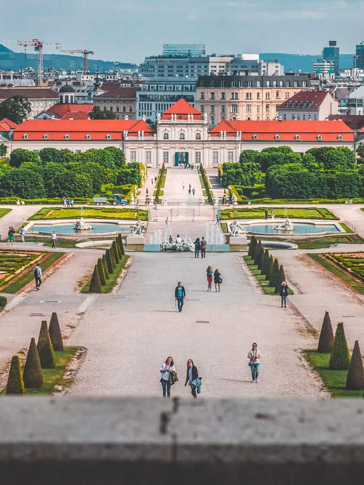 People walking at park at back of Belvedere palace in Vienna