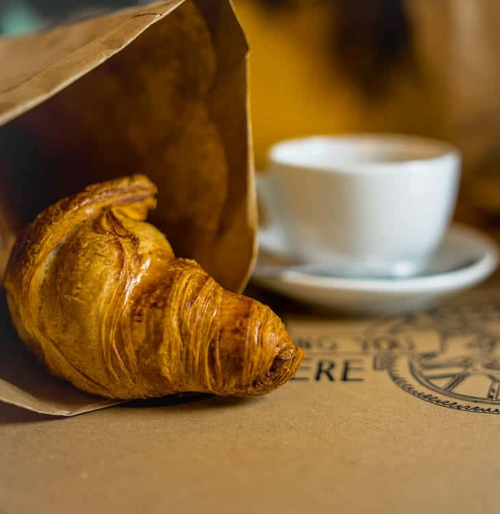 Breakfast croissant with coffee in Graz