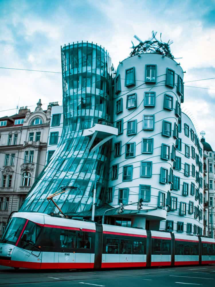 Tram passing next to Dancing house in Prague