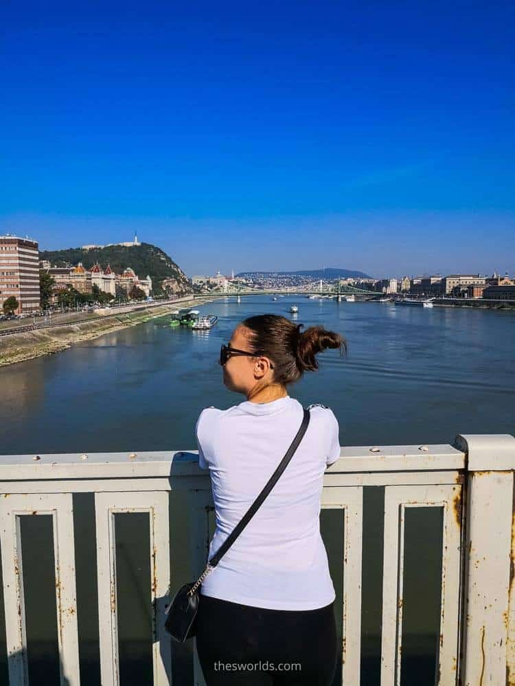 Girl looking at Danube river from bridge