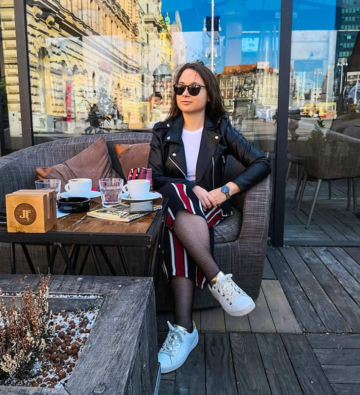 Girl posing while drinking coffee in Zagreb