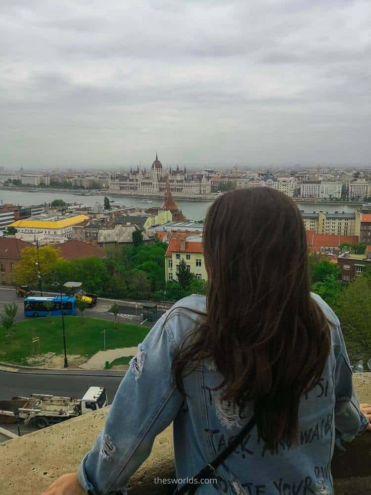 Girl looking at Hungarian parliament in Budapest
