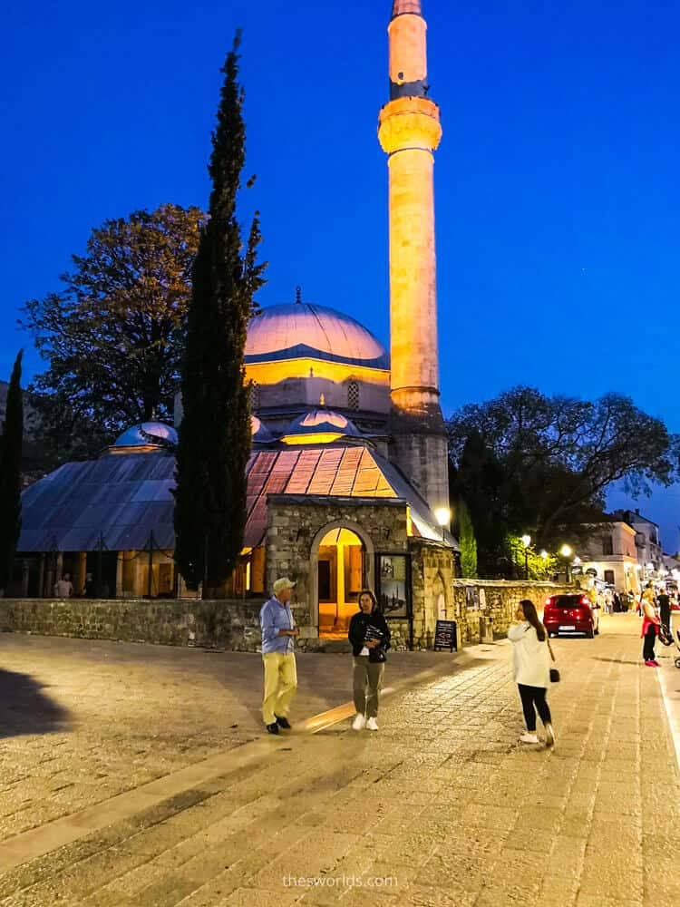 People in front of Koski Mehmed pasha mosque in Mostar