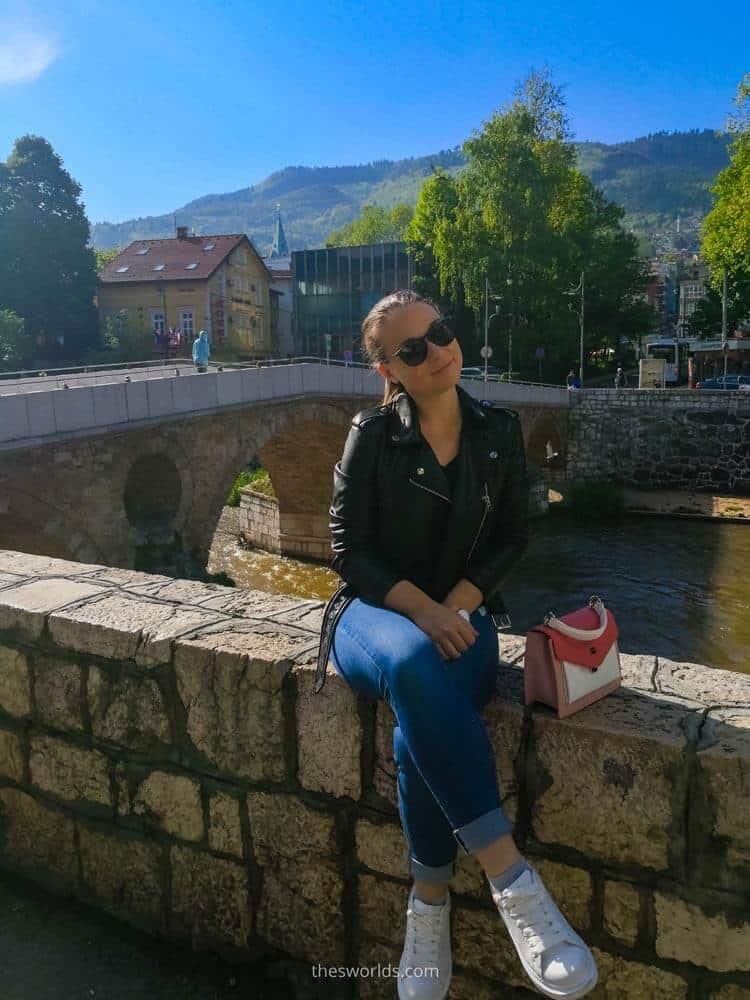 Girl sitting on Latin bridge in Sarajevo