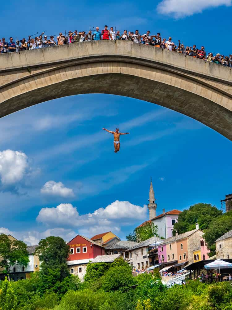 People watching a man jumping from Old bridge in Mostar