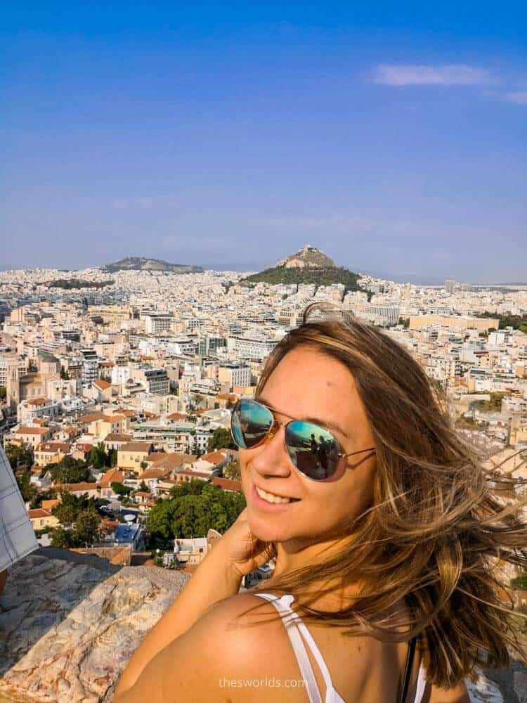 Girl looking at Mount Lycabettus in Athens