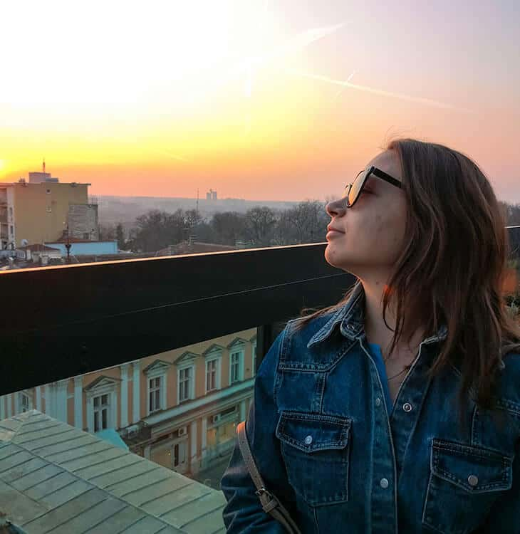 Girl looking at sunset at hotel rooftop in Belgrade