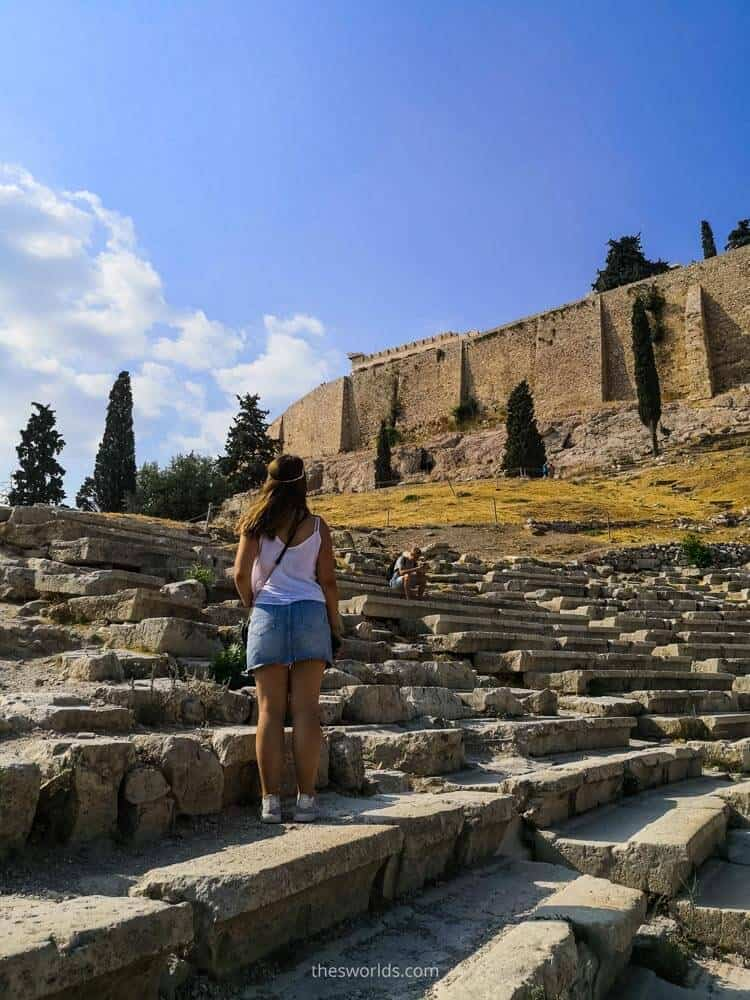 Girl standing at ancient stairs in Athens
