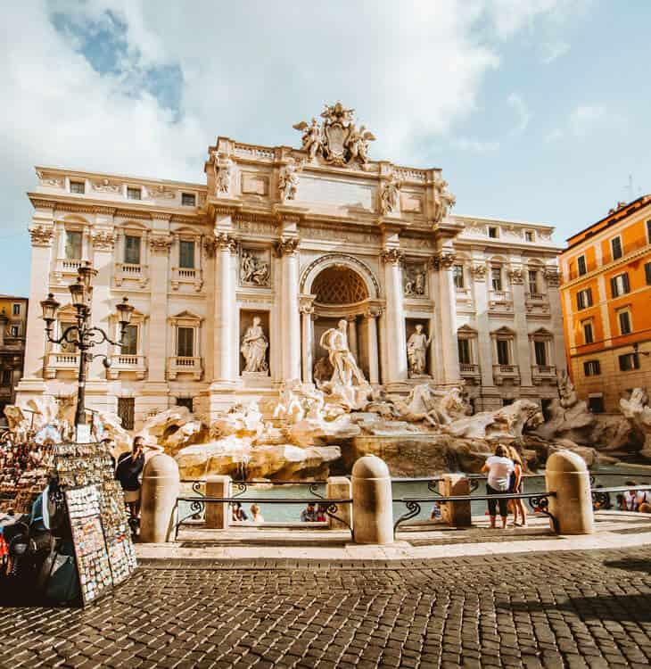 People taking pictures at Trevi fountain in Rome