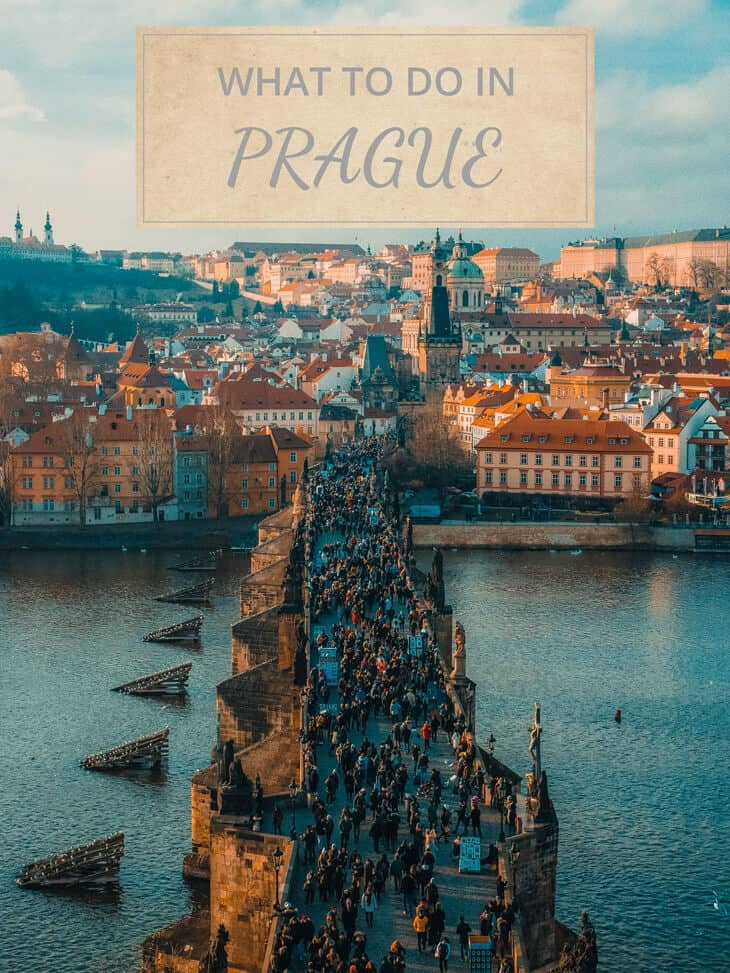 People walking on Charles bridges in Prague