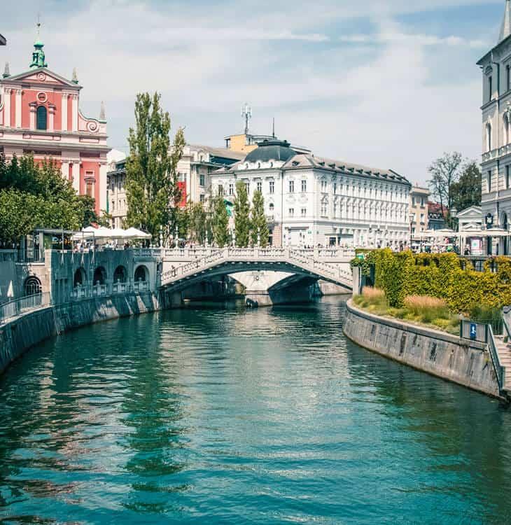 View of people walking over bridges in Ljubljana