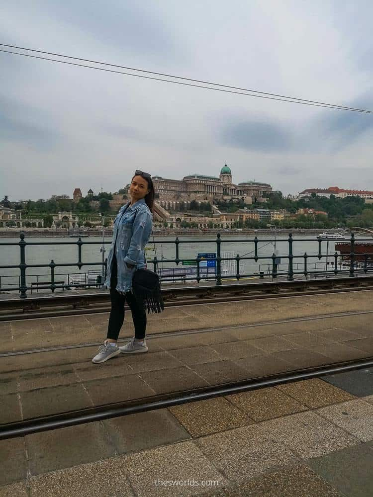 Girl posing in front of Buda Castle in Budapest