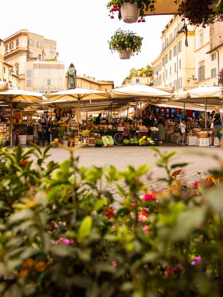 People shopping at city market in Rome