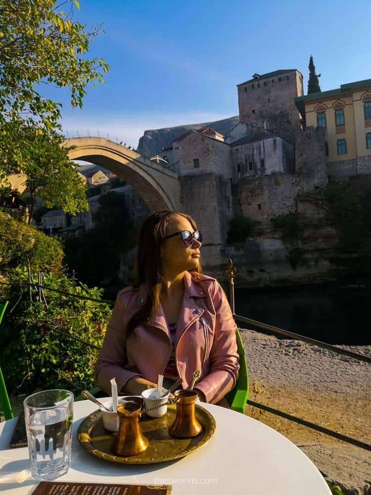 Girl drinking coffee in Mostar