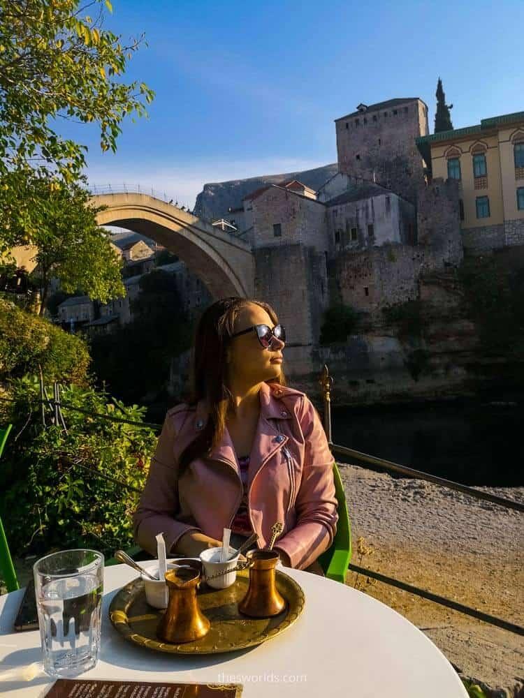 Girl drinking coffee in Mostar