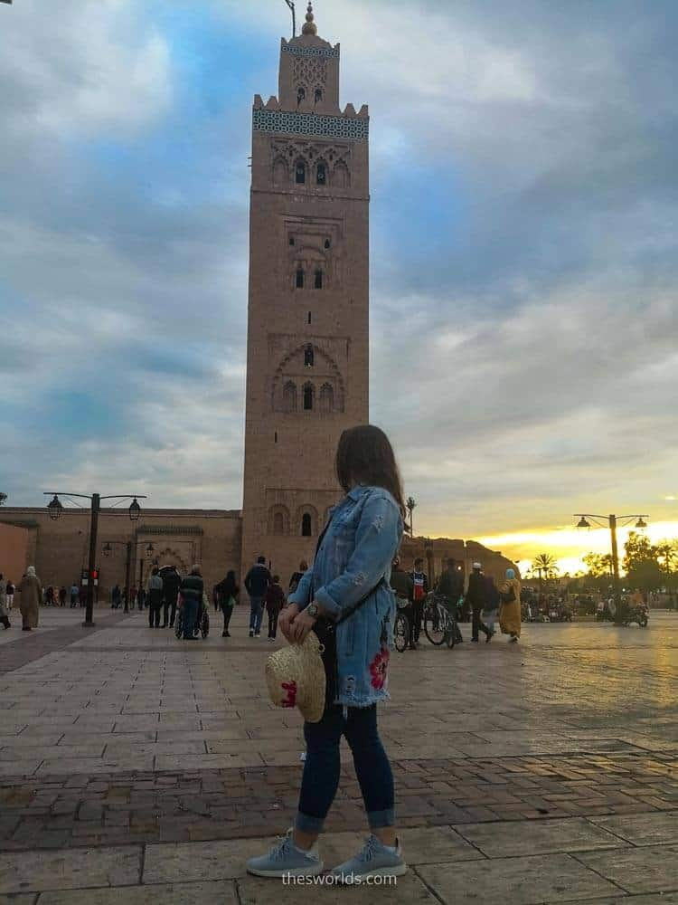 Girl posting in front of Koutoubia in Marrakech