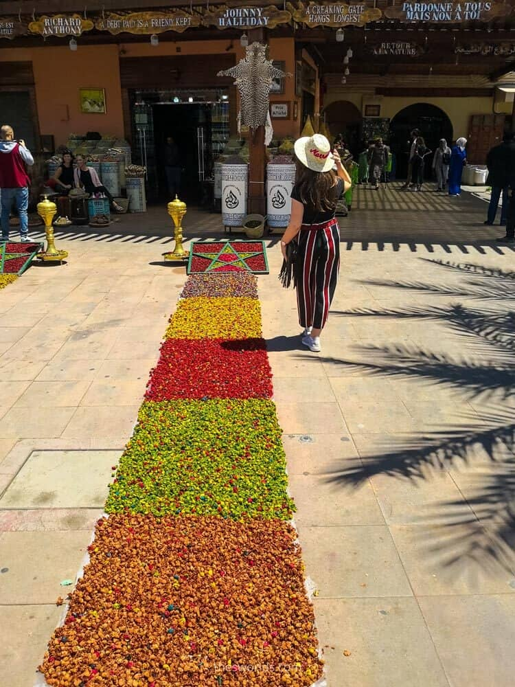 Girl posing next to morocco spices