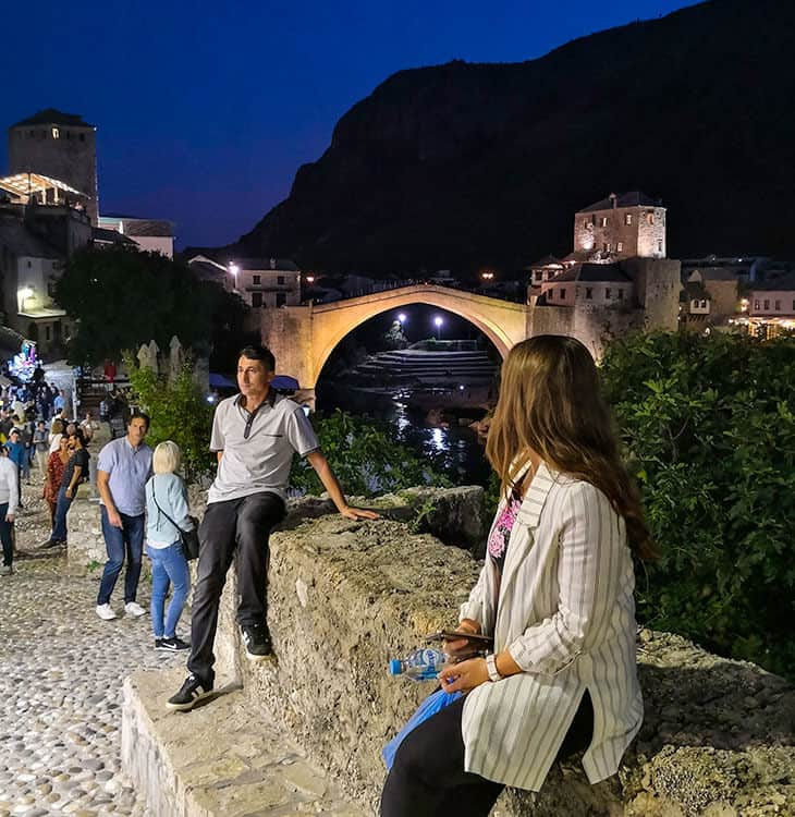Girl looking at Mostar old bridge