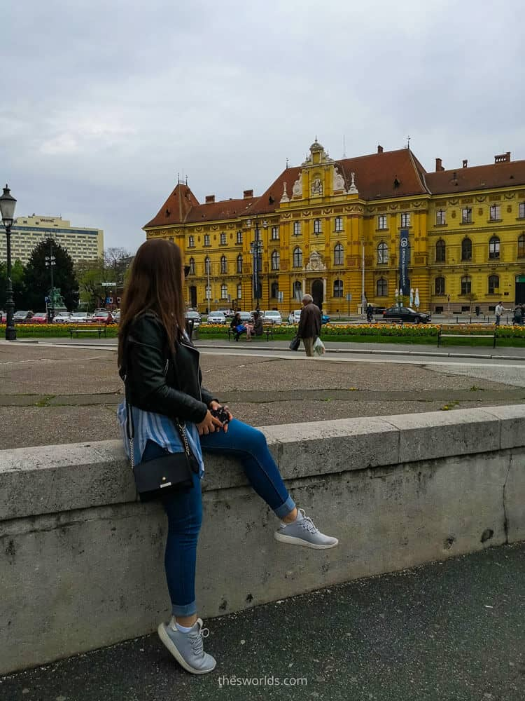 Girl posing in front of museum of Arts and Crafts in Zagreb