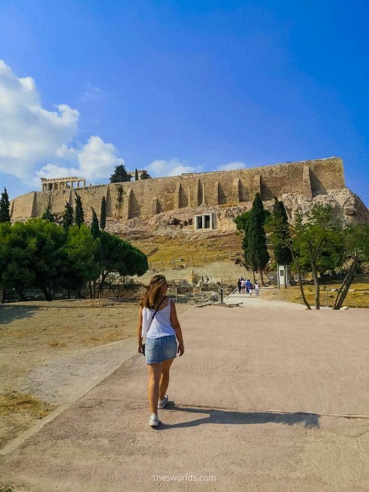 Girl walking to acropolis in Athens