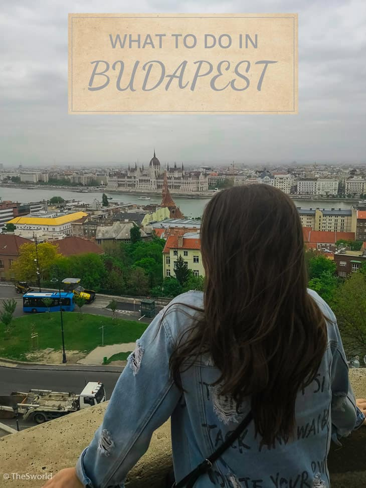 Girl looking at Budapest parliament