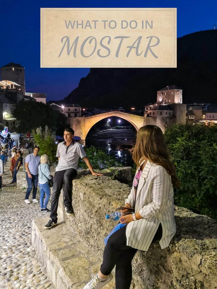 Girl looking at Old bridge in Mostar