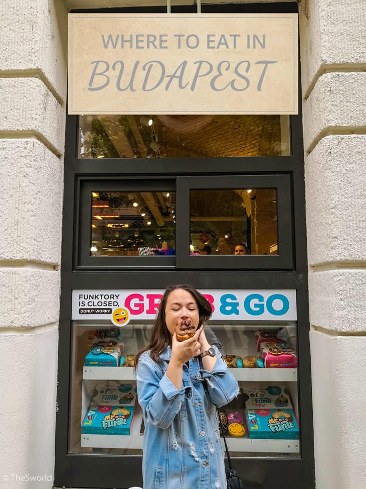 Girl eating donuts at Budapest
