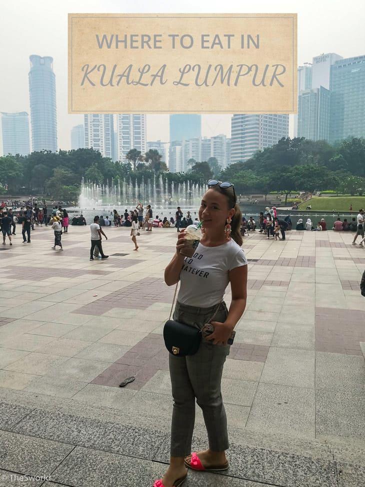 Girl drinking ice coffee at Kuala Lumpur park