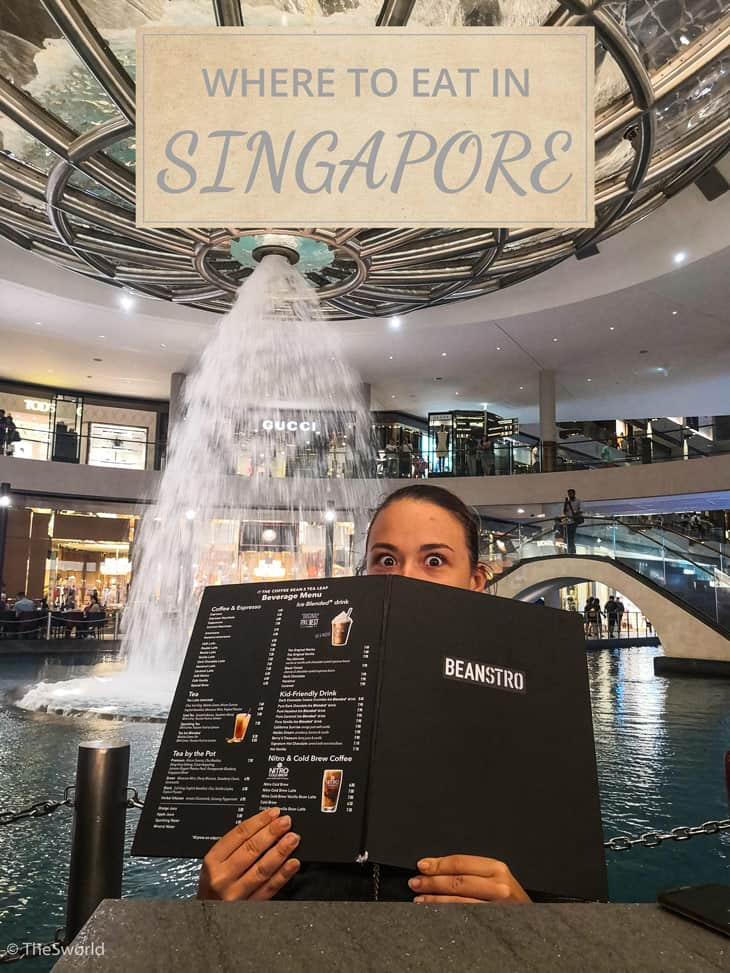 Girl reading what is on the menu at restaurant in Singapore