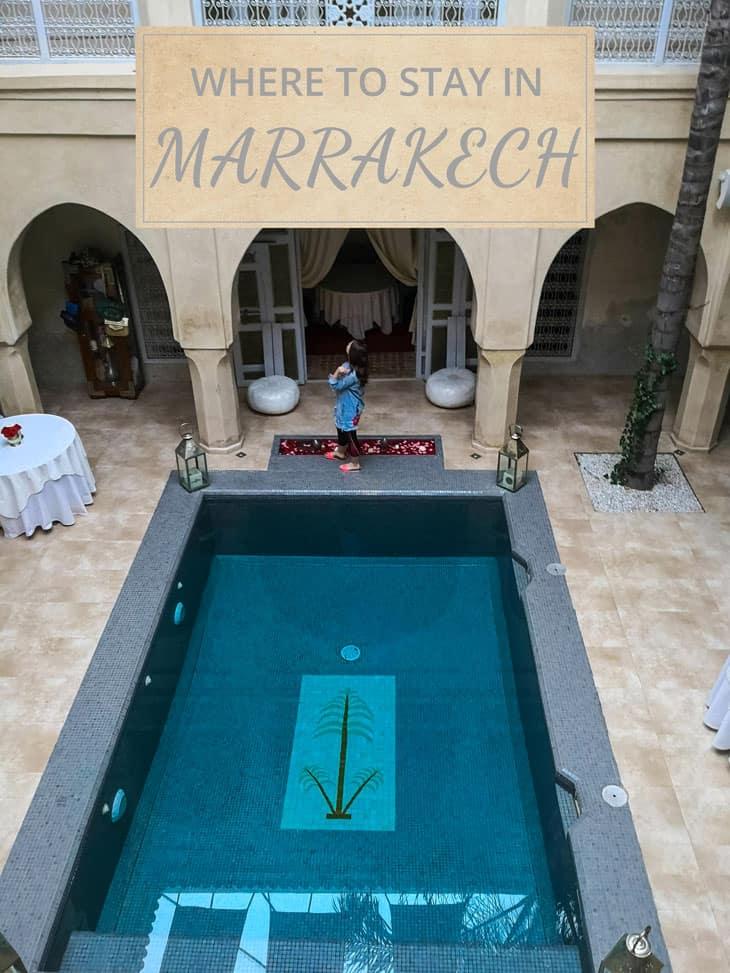 Girl standing in front of indoor swimming pool in Marrakech
