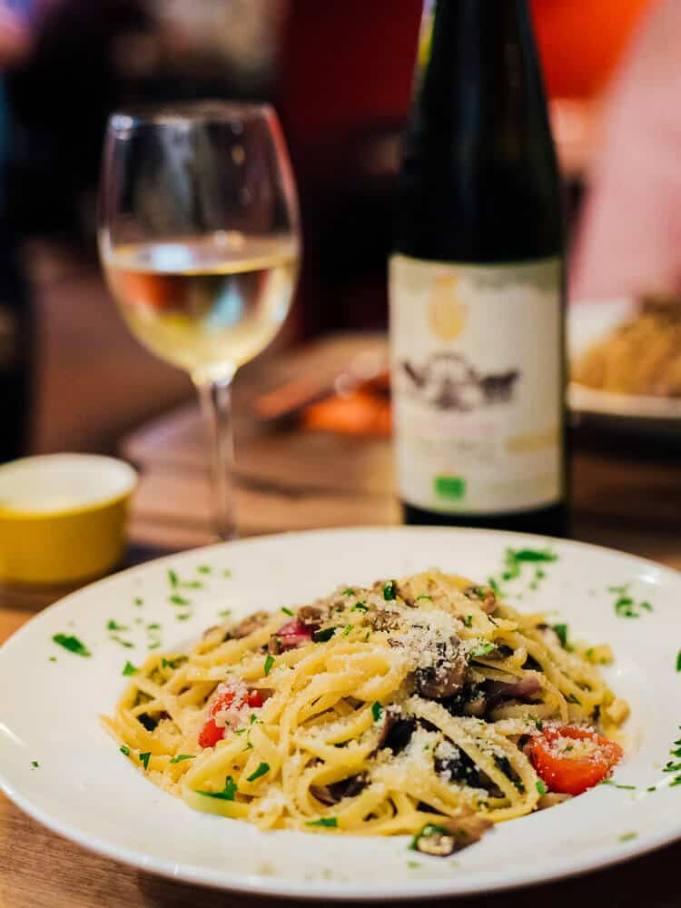 Eating pasta and drinking wine in Milan