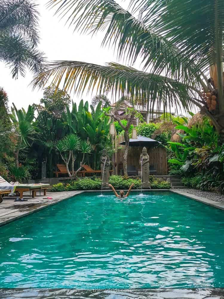 Girl swimming in swimming pool at Bali