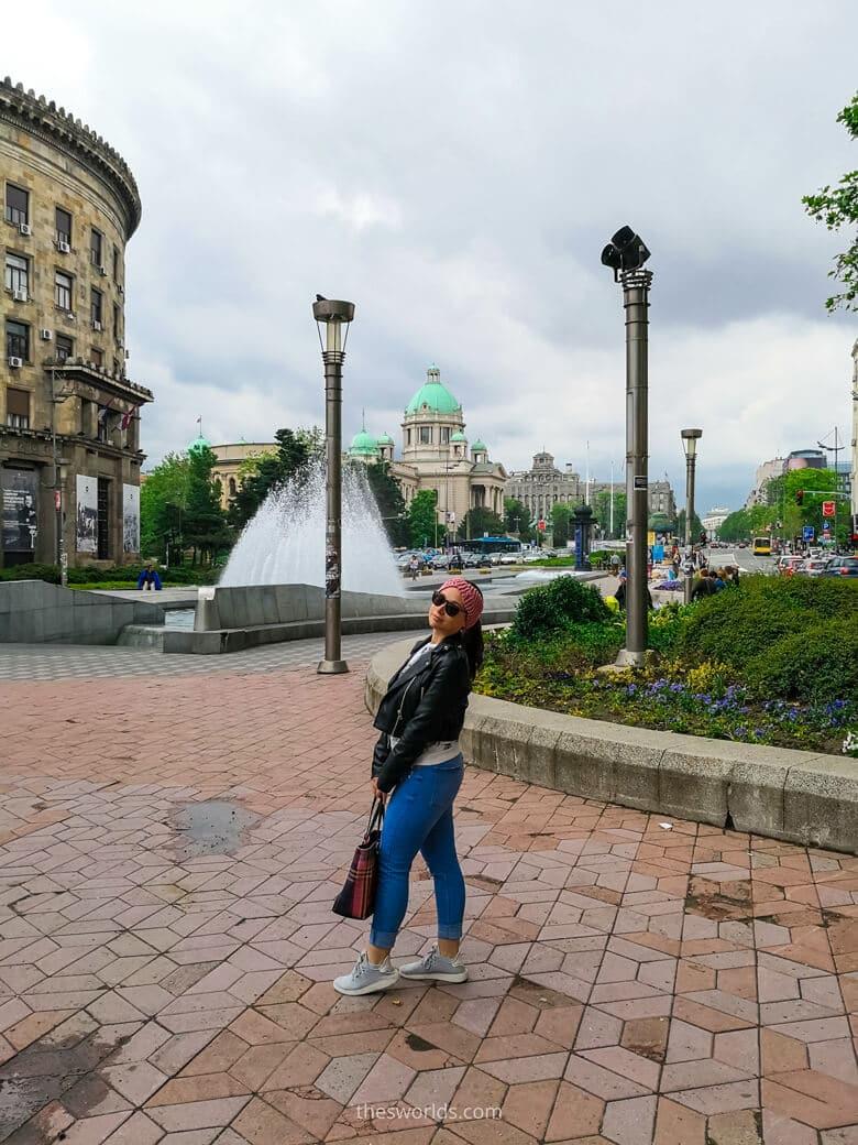 Girl posing in front of Belgrade parlament
