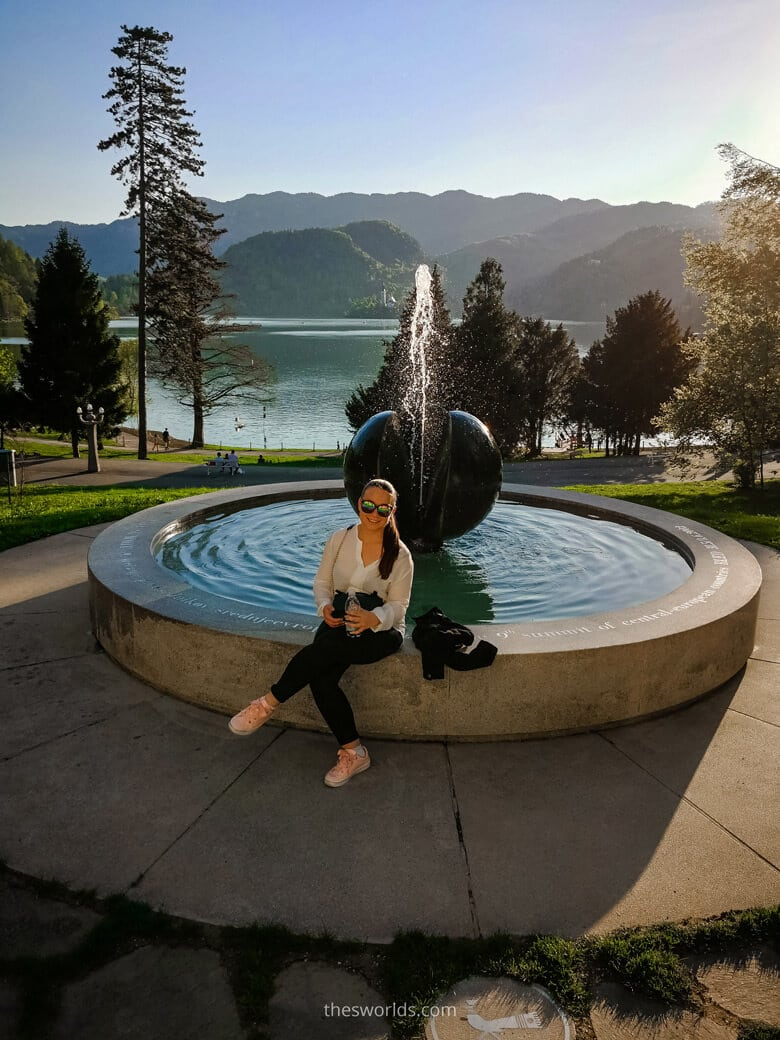 Girl posing in front of fountain at Bled Lake