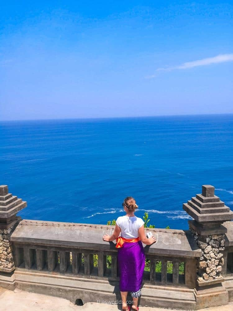Girl looking from a cliff from Uluwatu temple in Bali