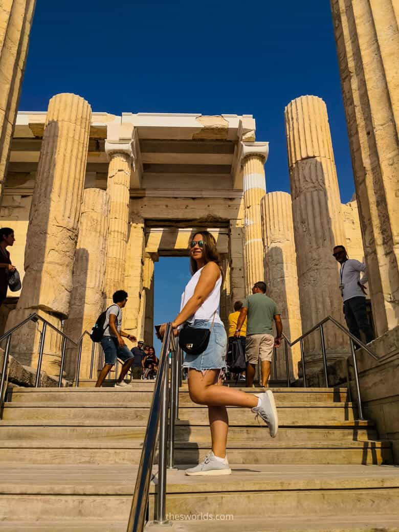 Girl posing in front of entrance to Parthenon