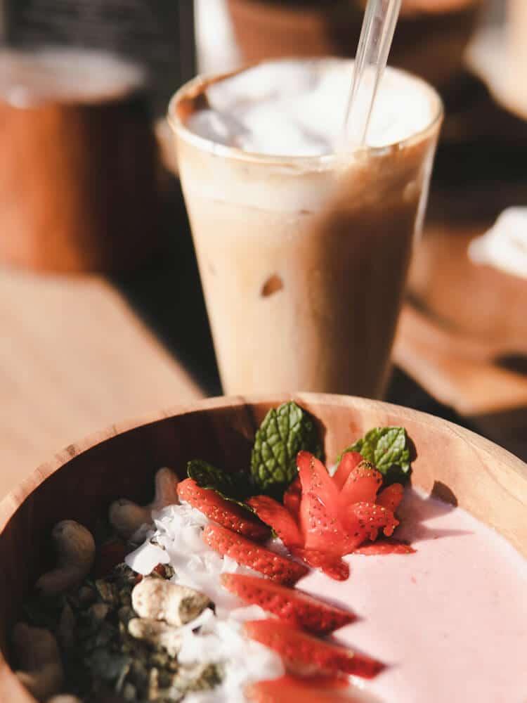Fruit bowl with cafe latte