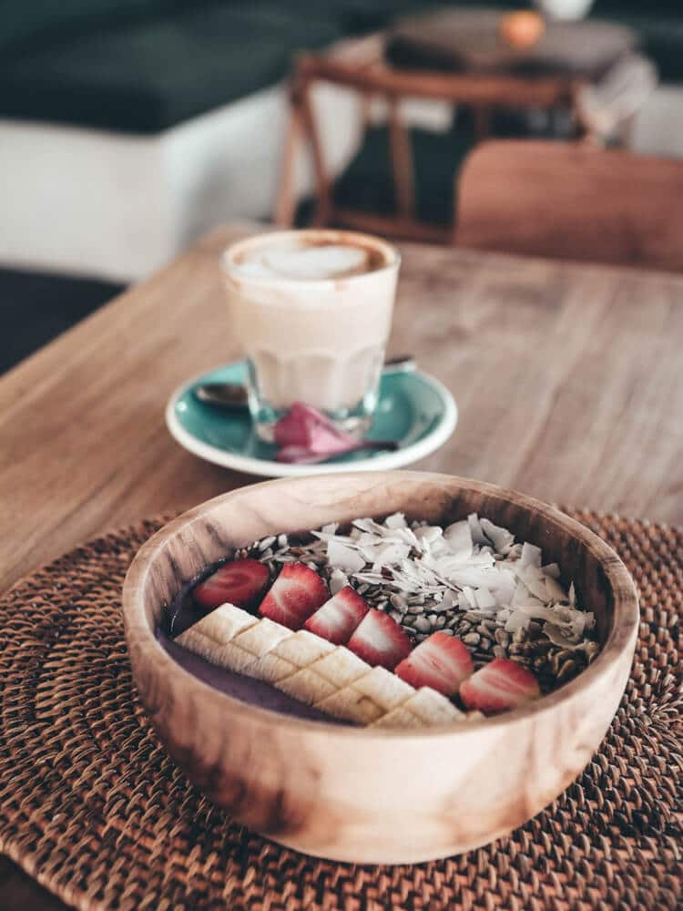 Fruit bowl with white coffee