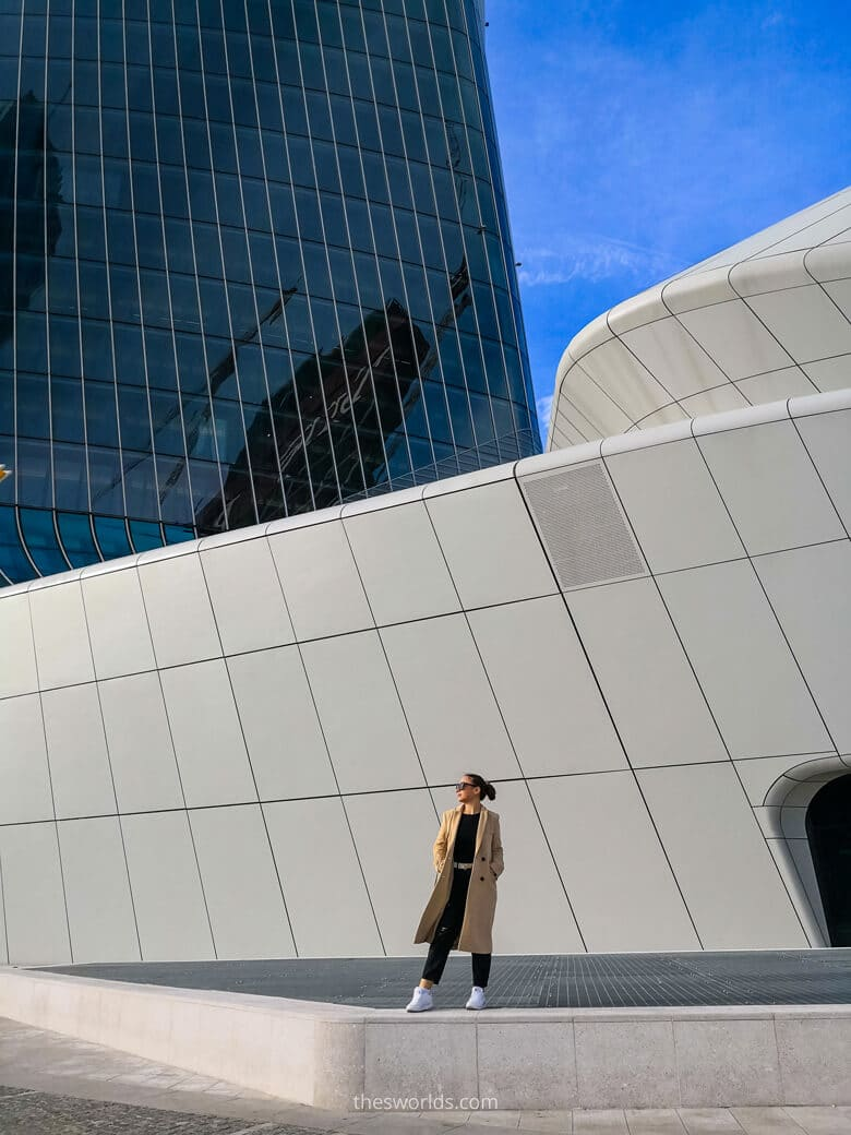 Girl standing in front of skyscraper at Gae Aulenti square in Milan