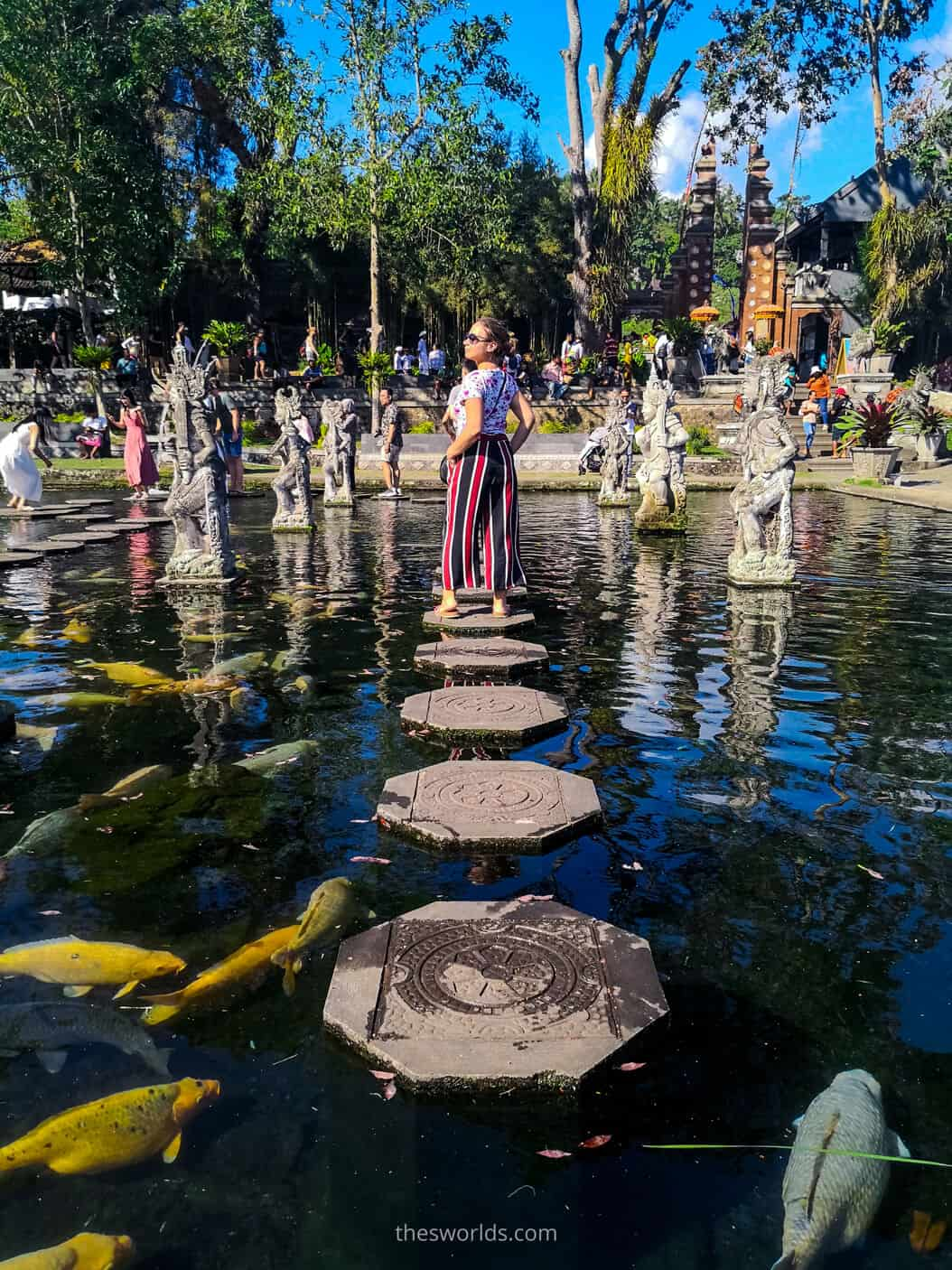 Girl posing on a rock in the water at Bali