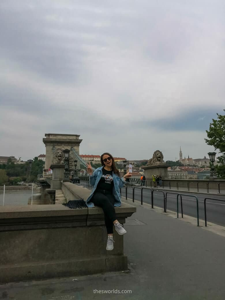 Girl sitting on Lion bridge in Budapest