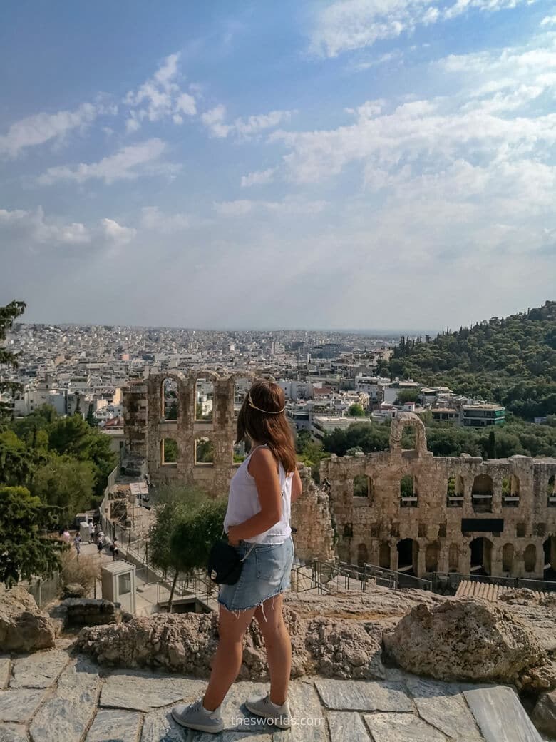 Girl looking at Athens city center from Acropolis