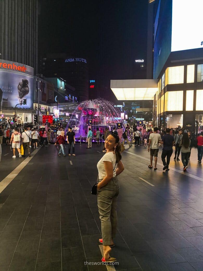 Girl standing at entrance to Pavillion Kuala Lumpur shopping mall