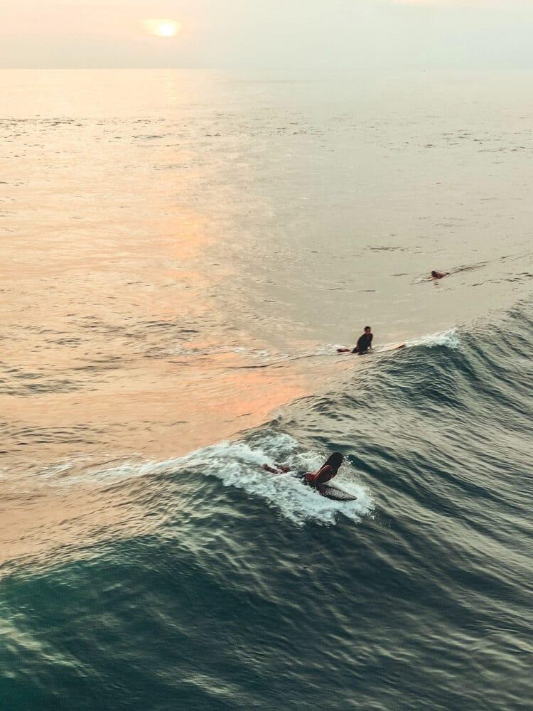 People surfing on waves at Canggu beach